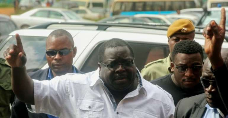 A leading critic of President Edgar Lungu, Chishimba Kambwili (C), has been arrested for defaming the president.  By DAWOOD SALIM (AFP)