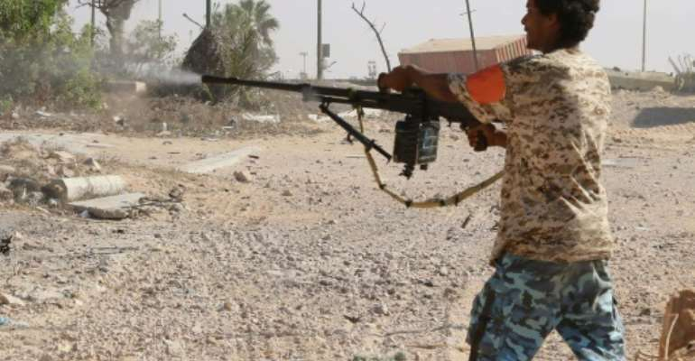 A Libyan pro-regime fighter with the Government of National Accord (GNA) fires at Islamic State jihadists during clashes for control of Sirte, on September 3, 2016.  By Mahmud Turkia (AFP/File)