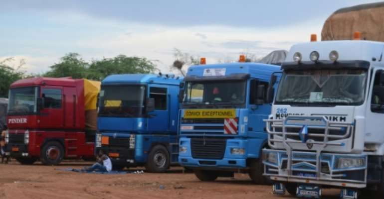 A long line of lorries from Niger and elsewhere in West Africa is stranded at Dan Issa after Nigeria closed its borders.  By BOUREIMA HAMA (AFP)