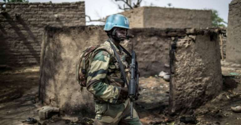 A member of the United Nation's mission in Mali, as UN experts accuse top officials of obstructed a 2015 peace deal.  By Marco LONGARI (AFP/File)