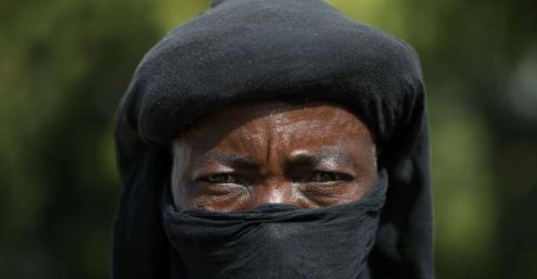 A member of the Yansakai vigilante group.  By Kola Sulaimon (AFP)