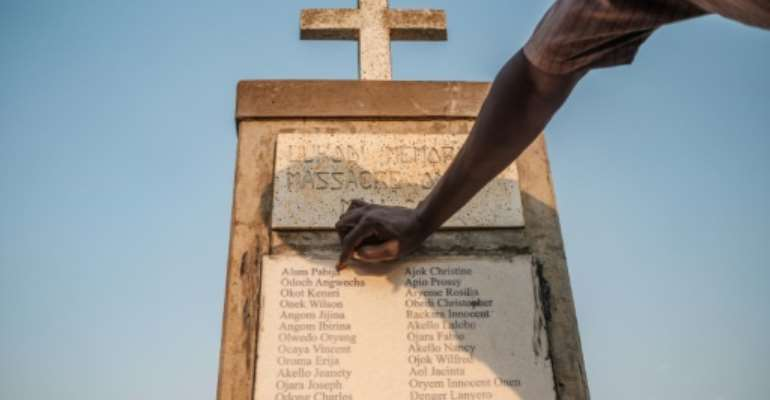 A memorial for victims of of an LRA massacre in Lukodi, Uganda.  By Sumy Sadurni (AFP)
