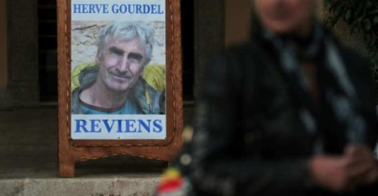 A memorial photograph of murdered mountaineer Herve Gourdel in his hometown in France, in this September 2014 picture. 'Herve Gourdel, come back', it reads in French.  By Jean-Christophe MAGNENET (AFP/File)