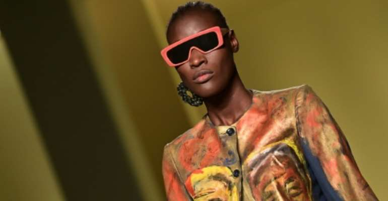 A model presents a creation by Senegalese fashion designer, Pape Mocodou Fall, aka Mokodu from the collective