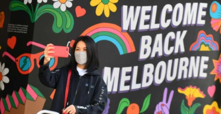 A months-long lockdown was lifted in Melbourne as Australia's second biggest city got its virus outbreak under control.  By William WEST (AFP)