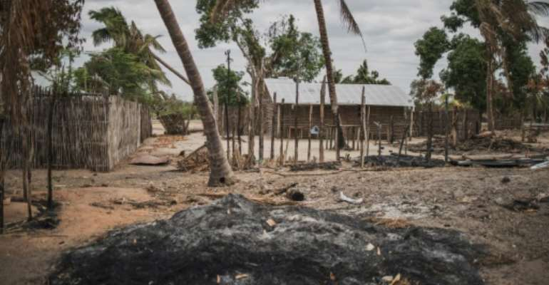A mound of ashes is seen in the recently attacked village of Aldeia da Paz outside Macomia, Mozambique, on August 24, 2019.  By MARCO LONGARI (AFP/File)