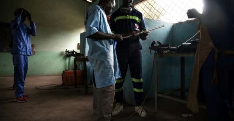 A new life: Former child soldiers learn how to weld at the Don Bosco training centre in Bangui.  By FLORENT VERGNES (AFP)