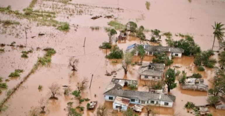 A picture shows houses in a flooded area of Buzi, central Mozambique after the passage of cyclone Idai..  By Adrien BARBIER (AFP)