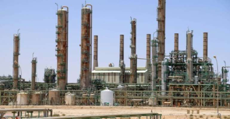 A picture taken on June 3, 2020 shows an oil refinery in Libya's northern town of Ras Lanuf.  By - (AFP/File)