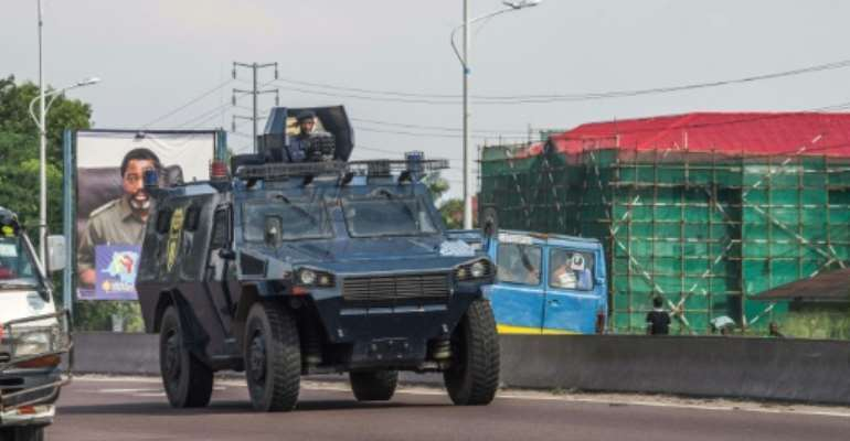 A police armored personnel carrier patrols in Kinshasa during a day of protest called by the opposition parties.  By JUNIOR D. KANNAH (AFP/File)