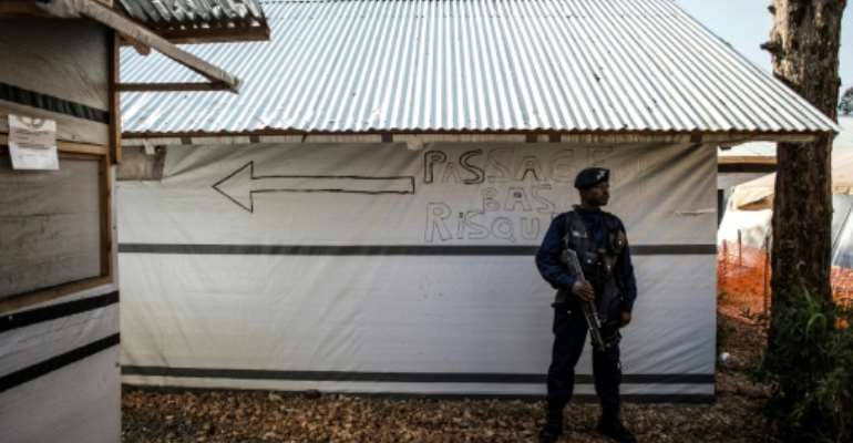 A police officer guards an Ebola treatment centre in Butembo, the epicentre of the current epidemic. Health workers are frequent targets of attacks.  By JOHN WESSELS (AFP)