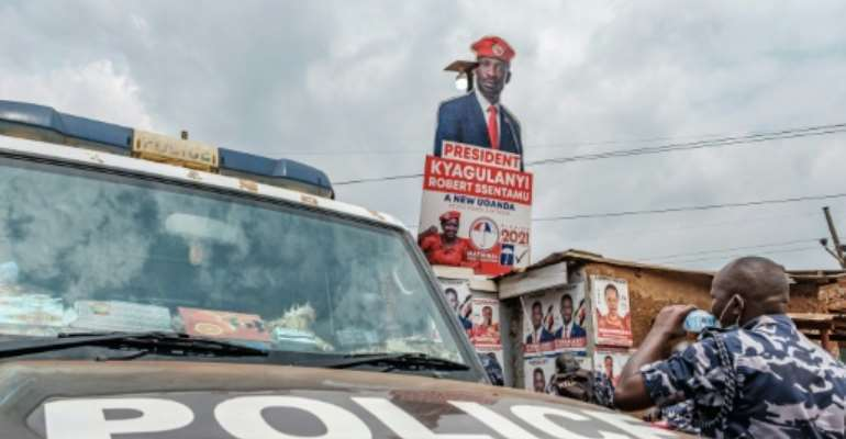 A police patrol car stationed outside the headquarters of Uganda's main oppposition party, the National Unity Platform.  By SUMY SADURNI (AFP)