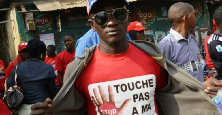 A protestor at a January rally wears a T-shirt reading 'Don't Touch My Constitution!' Conde's proposal to change the constitution has been hugely controversial.  By CELLOU BINANI (AFP/File)