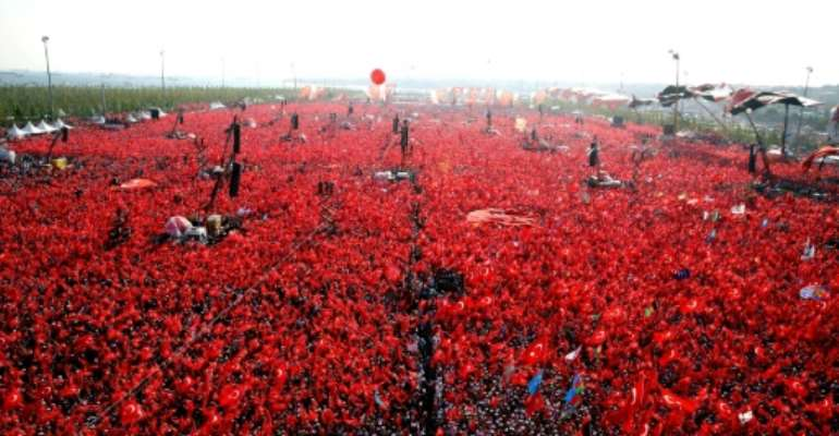 A rally after the failed coup.  By STR (TURKEY'S PRESIDENTIAL PRESS SERVICE/AFP/File)