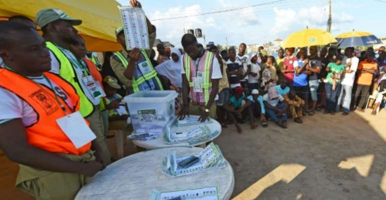 A runoff was declared after the election in Osun (voters pictured September 22, 2018) was declared inconclusive, but opposition parties are crying foul.  By PIUS UTOMI EKPEI (AFP/File)