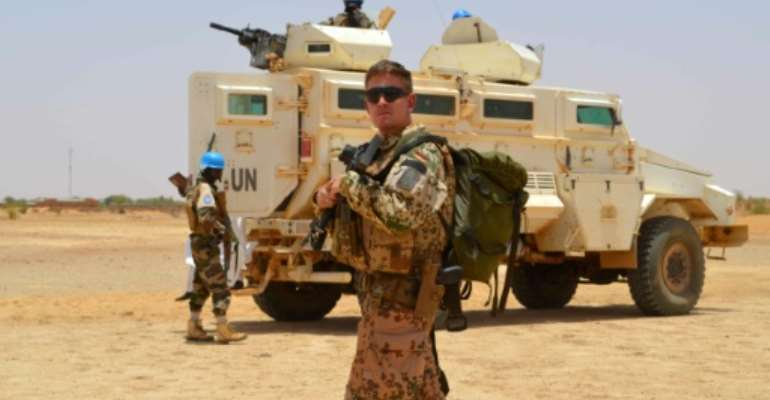 A Sahel force will have its headquarters in Mali but will be under a separate command from the UN peacekeeping force MINUSMA, a German solider of which is seen in April 2017, which has been deployed in the country since 2013.  By Souleymane AG ANARA (AFP/File)
