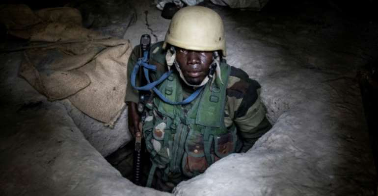 A Senegalese soldier inside a small underground bunker at a rebel base the army captured in Casamance.  By JOHN WESSELS (AFP)