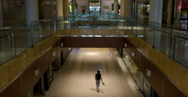 A shopper walks through The Galleria mall in Houston on the first day since the partial lifting of coronavirus lockdown measures.  By Mark Felix (AFP)