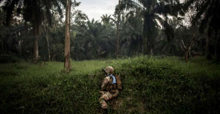 A soldier from the UN's DR Congo mission patrols for members of the ADF militia, which is thought to have killed more than 700 civilians since 2014.  By JOHN WESSELS (AFP)