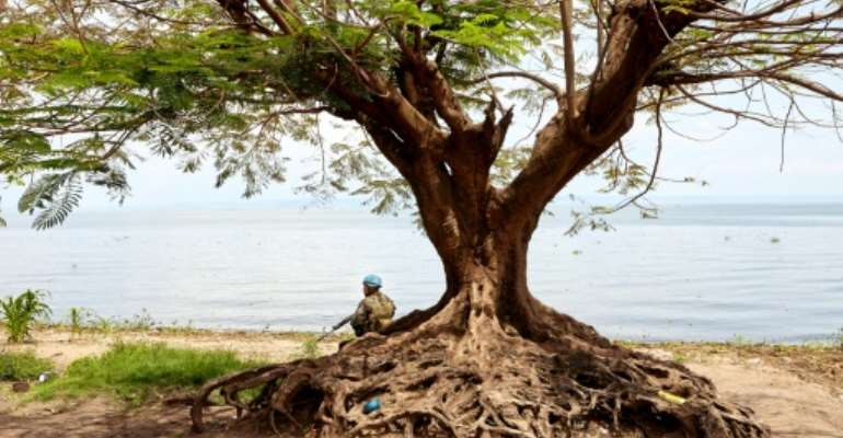A soldier on guard on Lake Albert where Uganda has jailed 35 DRC nationals for up to three years for illegal fishing.  By ALEX MCBRIDE (AFP/File)