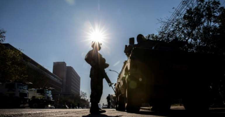 A soldier stands guard outside the High Court in Pietermaritzburg.  By GUILLEM SARTORIO (AFP)
