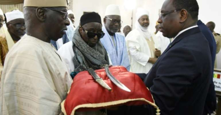 A sword and scabbard said to have belonged to Omar Saidou Tall, an important 19th-century military and religious figure in West Africa, are officially held by the Army Museum in Paris but are on long-term loan to Dakar.  By SEYLLOU (AFP/File)