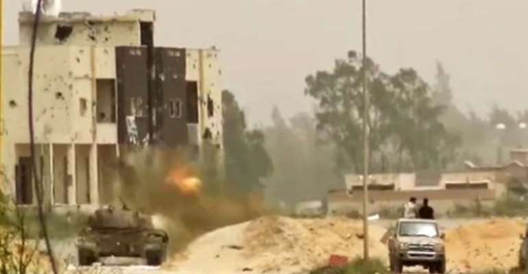 A tank in clashes on the outskirts of the Libyan capital Tripoli.  By - (LNA War Information Division/AFP)