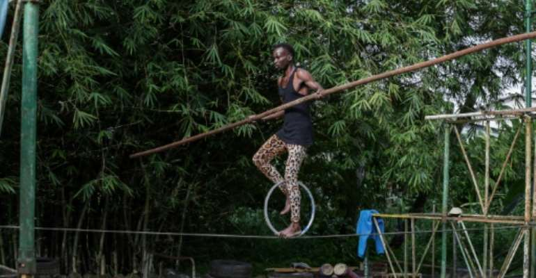 A tightrope-walker with
