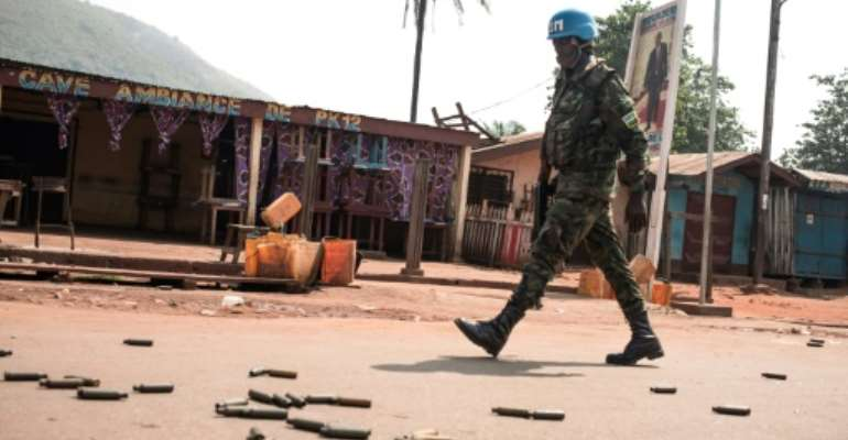 A UN peacekeeper patrols an area known as PK12 outside the Central African Republic's capital Bangui after a rebel attack.  By FLORENT VERGNES (AFP)