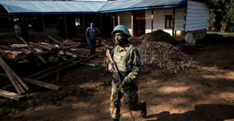 A UN peacekeeper patrols outside an Ebola treatment centre in Butembo in northeastern Democratic Republic of Congo.  By JOHN WESSELS (AFP/File)