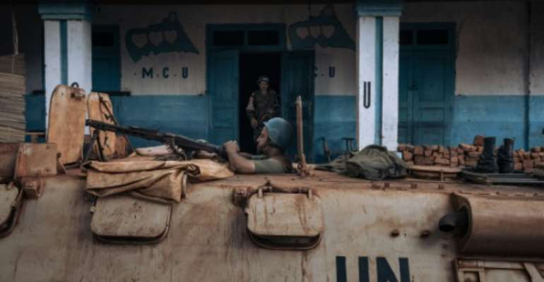 A UN peacekeeper patrols the Central African Republic city of Bangassou, which was seized by rebels.  By ALEXIS HUGUET (AFP)