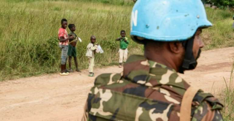 A UN soldier, part of MINUSCA mission in CAR where militia fighters are upsetting attempts to register voters for the presidential election in December.  By Camille Laffont (AFP)