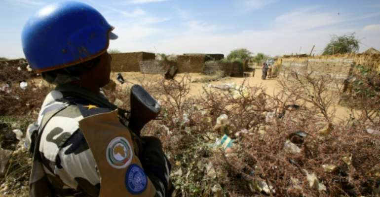 A United Nations peacekeeper stands guard at a UN refugee camp in the city of Nyala, in South Darfur, on January 9, 2017.  By Ashraf SHAZLY (AFP/File)
