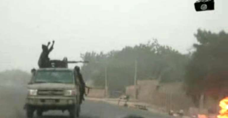 A video released on by Islamist group Boko Haram shows their fighters during a Christmas Day attack on a military checkpoint in Nigeria.  By Handout (BOKO HARAM/AFP/File)