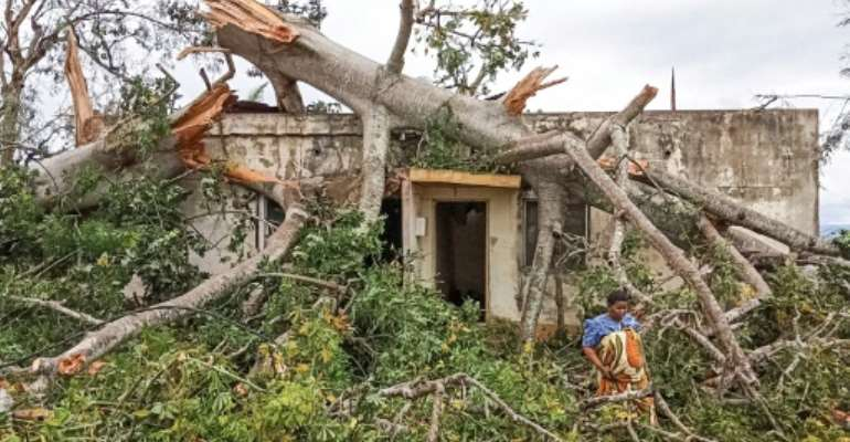 A woman inspects the damage caused by Cyclone Kenneth to her home in Macomia, in the north of Mozambique.  By Emidio Jozine (AFP)