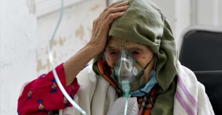 A woman with Covid-19 receives oxygen at the Ibn Jazzar hospital in  Kairouan on July 4, 2021.  By FETHI BELAID (AFP)