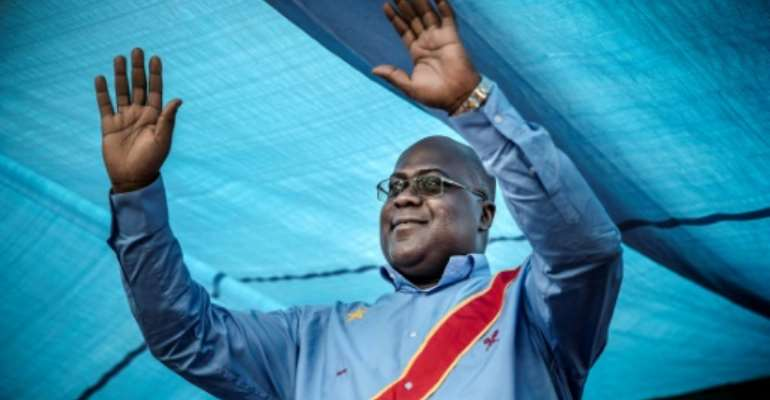 A year after he came to power, Tshisekedi's promises of fast-track change, with radical reforms to ease poverty and tackle corruption, have dimmed.  By Luis TATO (AFP)