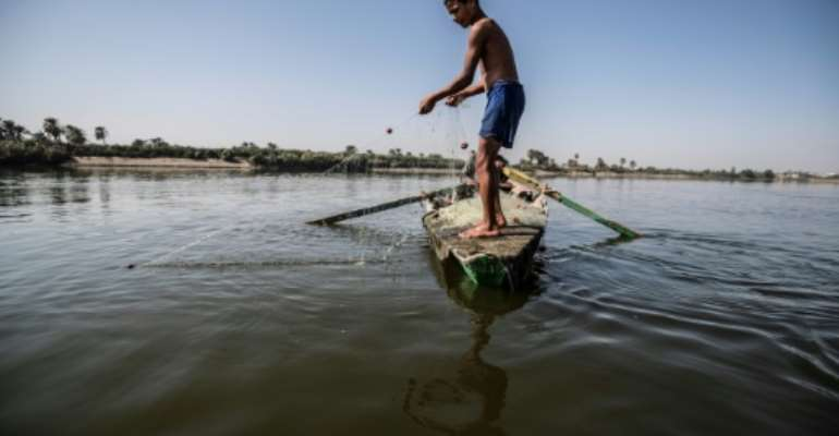 A young Egyptian fisherman pulls his net in the River Nile in a village near Minya, south of the capital Cairo.  By Khaled DESOUKI (AFP)