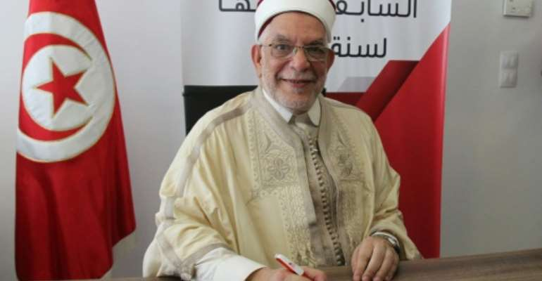 Abdelfattah Mourou, Tunisia's interim parliament speaker from the Islamist-inspired Ennahdha party, submits his candidacy for the September 15 presidential election.  By HASNA (AFP)