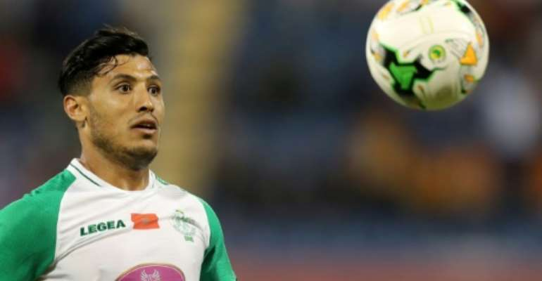 Abdelilah Hafidi put Raja Casablanca ahead in a victory at Olympique Khouribga that moved his club closer to the Moroccan title..  By KARIM JAAFAR (AFP)