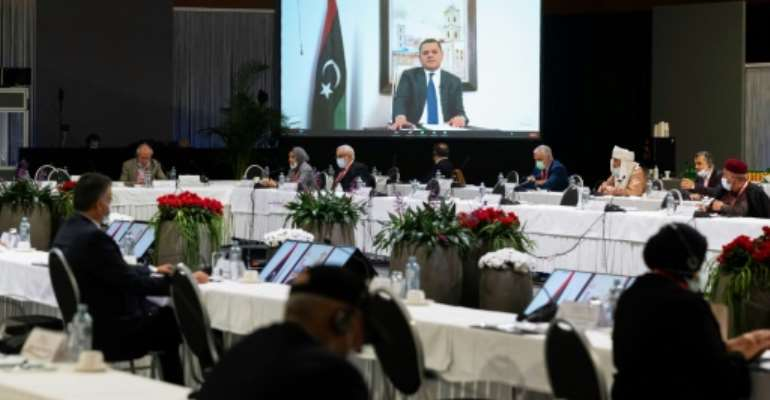 Abdul Hamid Mohammed Dbeibah delivers a speech via video link during a meeting of the Libyan Political Dialogue Forum.  By Handout (UNITED NATIONS/AFP)