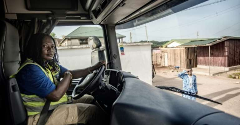 Abigail Asumadu-Amoah (pictured) is one of the 21 lorry drivers on the all-women team at Ghana's Ladybird Logistics.  By CRISTINA ALDEHUELA (AFP)