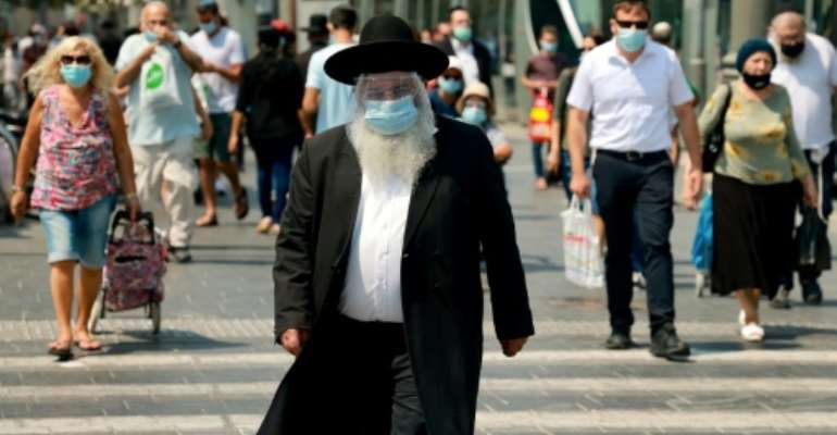 According to an AFP tally, Israel is second only to Bahrain for the world's highest coronavirus infection rate by population.  By EMMANUEL DUNAND (AFP)