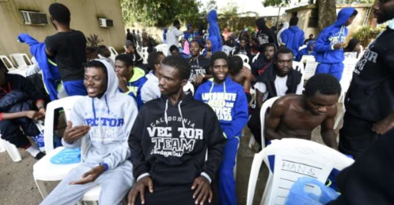 According to the authorities, there are more than 5,000 Nigerians in Libya, but those who have come back say there are many more.  By PIUS UTOMI EKPEI (AFP)