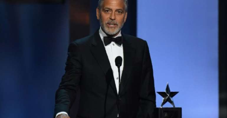 Actor and activist George Clooney, seen here in 2018, says that the toppling of Sudan's veteran leader Omar al-Bashir is not sufficient.  By VALERIE MACON (AFP/File)