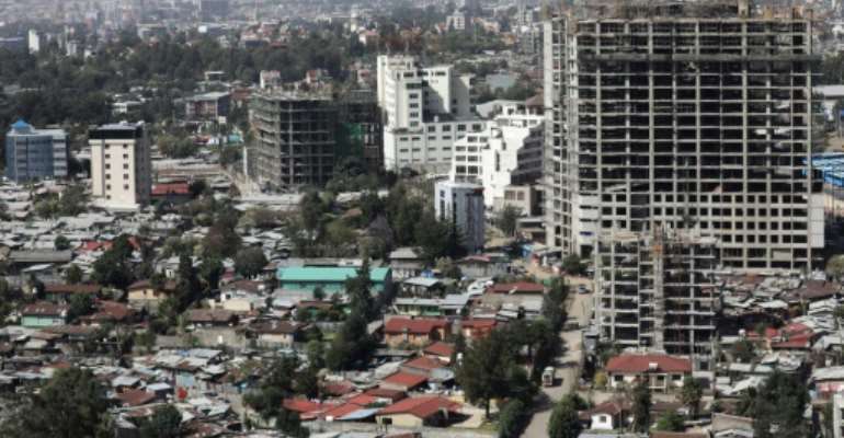 Addis Ababa has become a bustling, fast-changing city where modern buildings have shot up, construction is ever-present and greenery scarce.  By Ludovic MARIN (AFP)