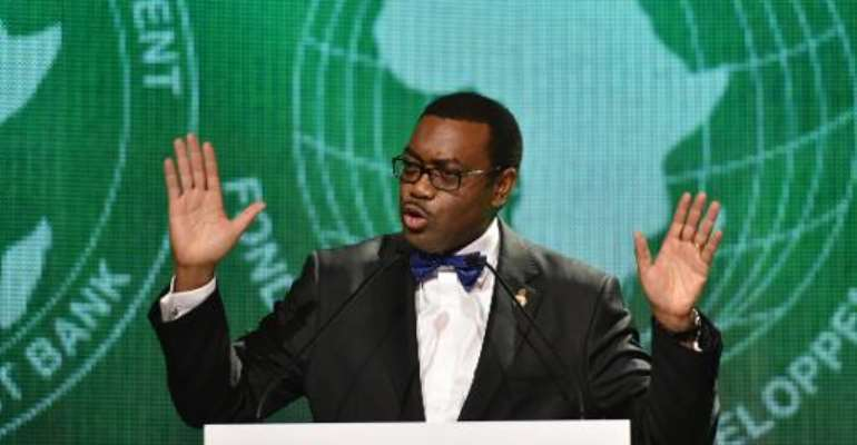 The new president of the African Development Bank Akinwumi Adesina delivers a speech on May 28, 2015 in Abidjan following his election.  By Sia Kambou (AFP/File)