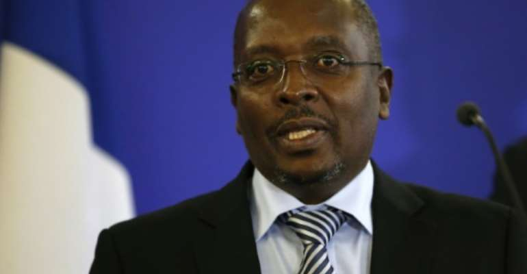 Burundian journalist Esdras Ndikumana delivers a speech after receiving the Diplomatic press award, on January 11, 2016 at French Foreign ministry in Paris.  By Patrick Kovarik (AFP/File)