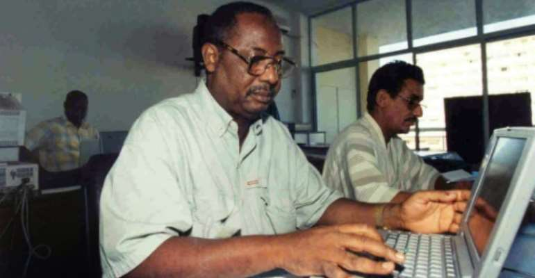 AFP's former correspondent in The Gambia, Deyda Hydara, left, pictured in the agency's Dakar bureau in 1999.  By Seyllou (AFP/File)