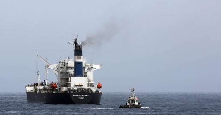 An oil tanker during the unloading of oil in the Libyan sea port of Zawiya on April 4, 2014.  By Mahmud Turkia (AFP/File)